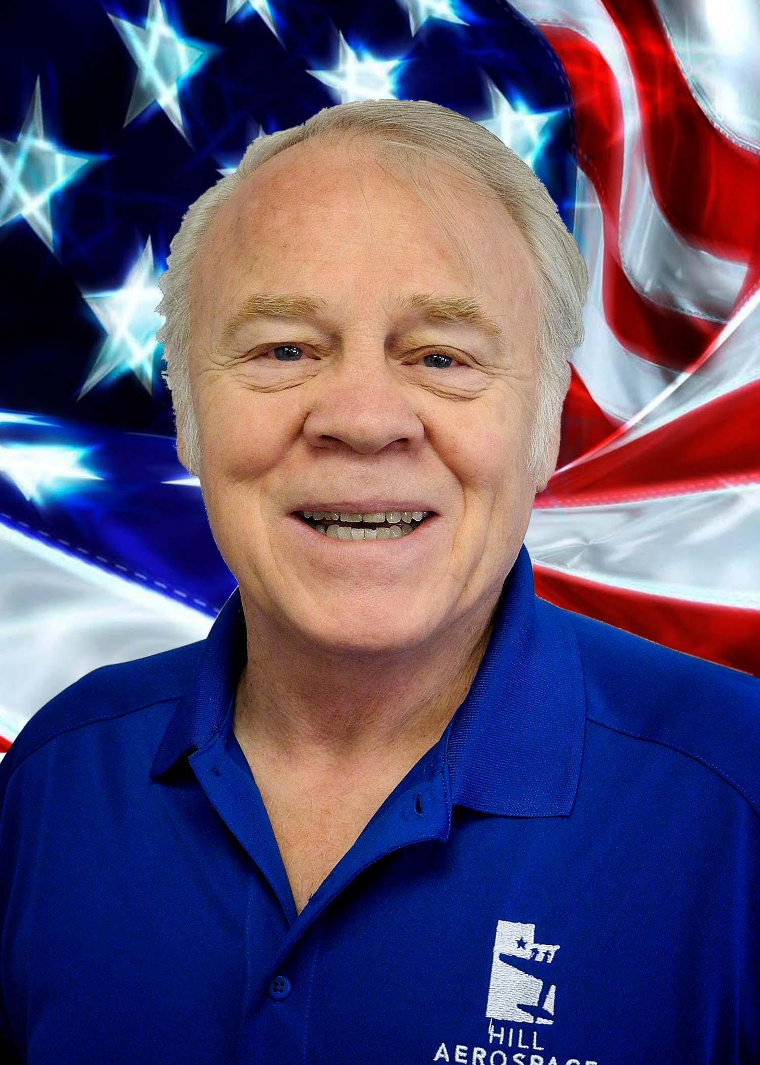 Hill Aerospace Foundation Volunteer, John Adrian with US Flag