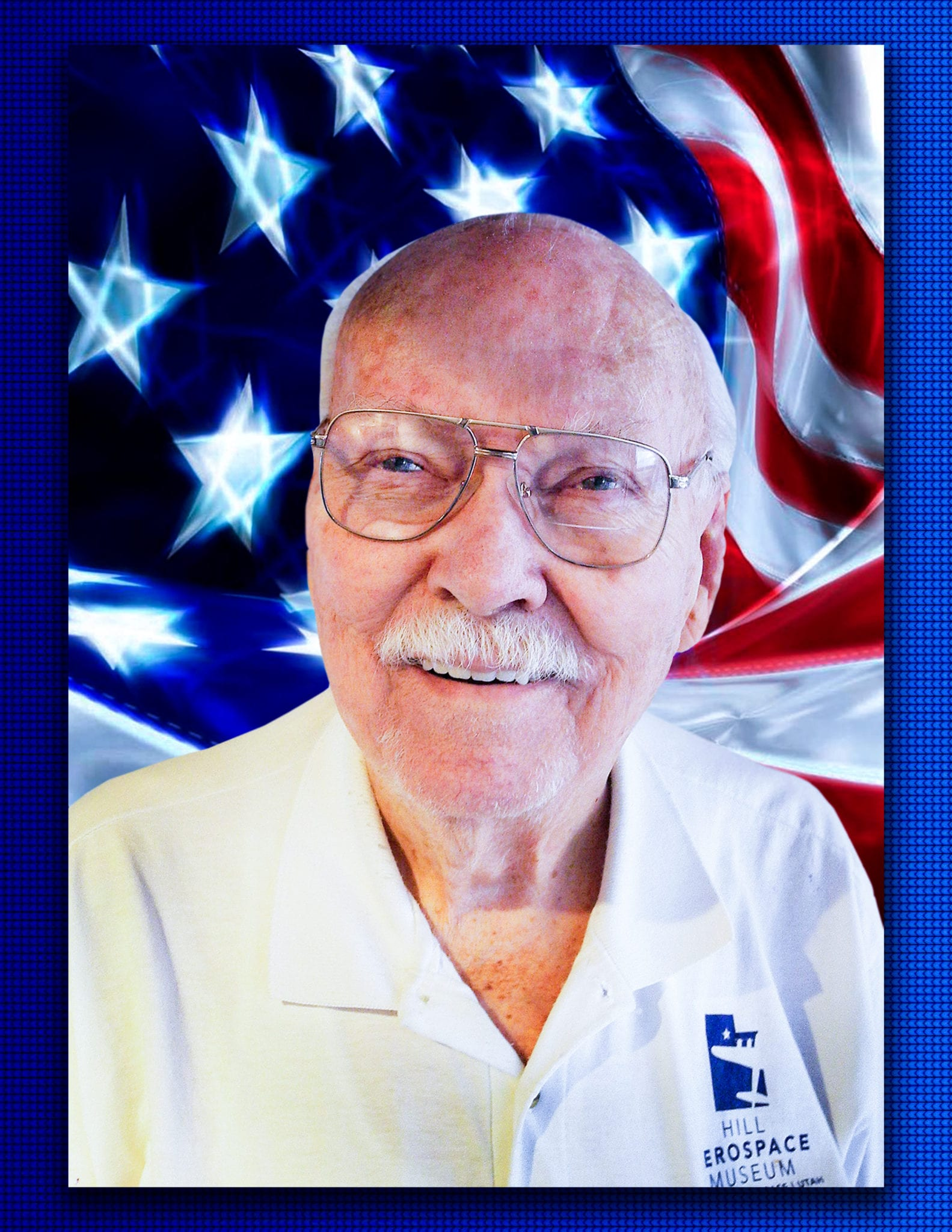 Hill Aerospace Foundation Volunteer, John Adrian with US Flag