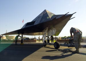 Members of Team Holloman position the F-117 Nighthawk stealth fighter into Heritage Airpark for static display at Holloman Air Force Base, NM. (U.S. Air Force photo by Airman 1st Class Leah Ferrante)