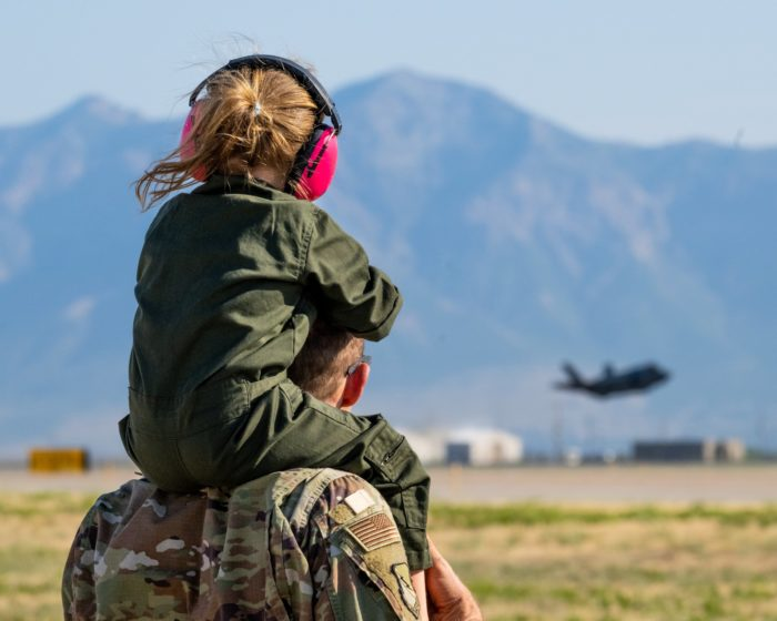 Father and daughter watch F-35 Lightning take off