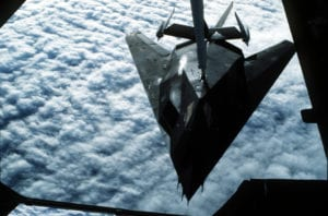 A U.S. Air Force F-117A Nighthawk stealth fighter from the 37th Tactical Fighter Wing refuels from a U.S. Air Force KC-10 Extender aircraft from the 22nd Air Refueling Wing, en route to Saudi Arabia in support of Operation Desert Shield. (U.S. Air Force Photo)